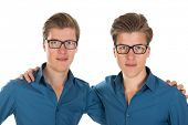 Identically adult male twins in studio