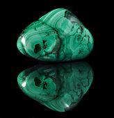 stock photo of malachite  - Polished malachite stone close up with reflection on black surface background  - JPG