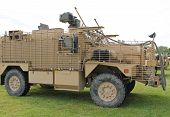 image of khakis  - A Khaki Coloured Military Armoured Heavy Vehicle - JPG