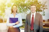Two bussiness partners man and woman over office background
