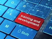 Education concept: Training and Development on computer keyboard