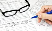 Glasses, Financial Documents And Male Hand With Pencil