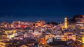 picture of greek-island  - Panoramic view of the citylights of Corfu Town at night - JPG
