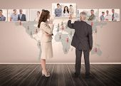 picture of coworkers  - Business people selecting digital interface together showing coworkers - JPG
