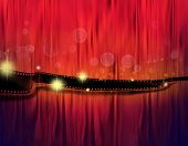 stock photo of yesteryear  - Strip of film on red tone background - JPG