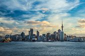 stock photo of dock  - Dramatic shot of Auckland City moody skies and rough seas