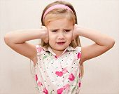 picture of disobedient  - Disappointed cute little girl covering her ears - JPG