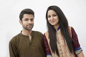Portrait of young couple wearing traditional clothing from Pakistan