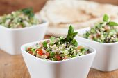 picture of flat-bread  - Gourmet Middle Eastern salad Tabbouleh in white bowls - JPG