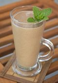 stock photo of frappe  - Banana and chocolate milk shake with fresh mint - JPG