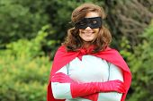 Young woman with red super heroes kit smiling
