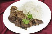Mutton liver fried with onion and indian spices to make a traditional Kerala (South India) fry, serv