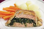 Salmon fillet stuffed with a spinach mixture and encased in puff pastry, served with boiled new pota