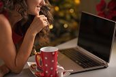 Closeup On Young Woman Having Christmas Cookies With Cup Of Hot