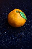 Ripe sweet tangerine, on dark color background
