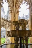 Batalha, Portugal - July 17, 2013: Fountain in the Royal Cloister of the Batalha Monastery. A masterpiece of the Gothic and Manueline art. Portugal. UNESCO World Heritage Site.