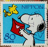 JAPAN - CIRCA 2000: A stamp printed in japan shows Snoopy, circa 2000