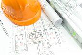 Construction Plans And Orange Helmet