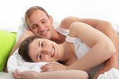 Smiling Loving Couple Lying In Bed