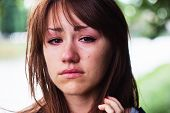 stock photo of cry  - Portrait of a beautiful girl who cries and sad - JPG
