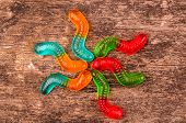 pic of gummy bear  - gummy bears candy assorted on a dark background - JPG