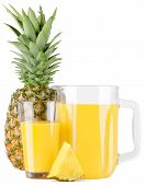 Glass pitcher with pineapple juice and pineapple