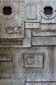 Metal door with porthole
