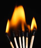 Burning matches isolated on black