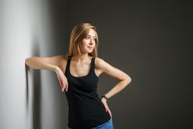 stock photo of jeans skirt  - Beautiful young woman wearing jeans and black t - JPG