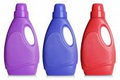 Set of bottles of detergent different flavors on white background