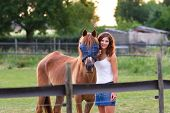 Beautiful Young Woman With A Horse At Sunset