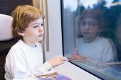 Little Tired Boy In A High Speed Train
