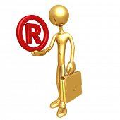 Businessman Holding Registered Symbol