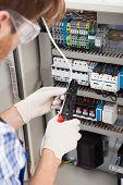 Electrical Engineer Repairing Fusebox