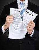 Businessman Tearing Contract Paper