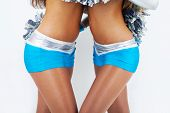Two cheerleaders holding each other