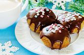 Profiteroles With Chocolate Icing And Colored Powder