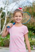 Cute Girl With Racket Outdoors