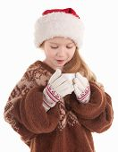 picture of cute little girl  - girl in a sweater Santa Claus hat and with cup - JPG