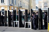 Frame metal detectors, police