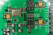 Printed Circuit board from a computer in black with green lines