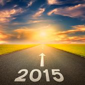 Driving On An Empty Road Towards The Sun To 2015