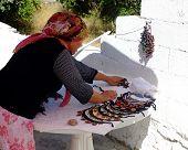 Village woman preparing her local stall