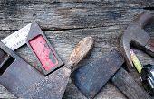 Old Vintage Hand Tools On Wood Background