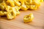 Closeup of uncooked tortellini on the table