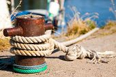 foto of bollard  - bollard with a rope tied to a pier - JPG