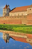 Medieval Castle mirrored in water
