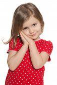 Shy Preschool Girl Against The White