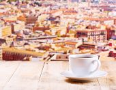 Cup Of Coffee On Wooden Table Over Cityscape