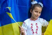 In National Costume Against Of Ukrainian Flag